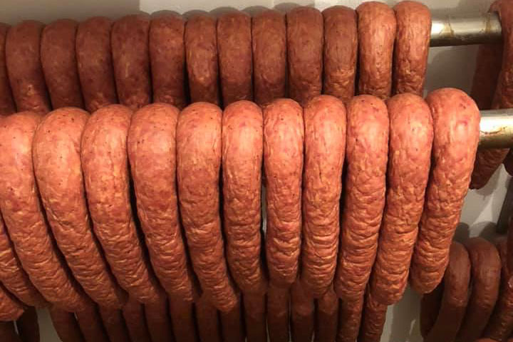 rows of farmers sausage hanging to cure